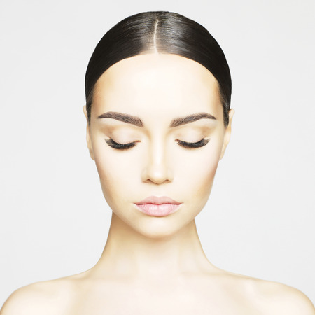 Studio portrait of beautiful young woman with perfect skin. Beauty and care. Extension eyelashes. Spa salon Foto de archivo
