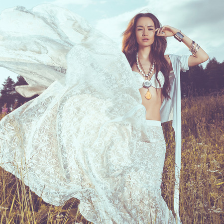 Outdoors fashion photo of beautiful bohemian lady