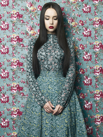 Fashion art photo of beautiful elegant lady on floral background. Spring-Summer Imagens