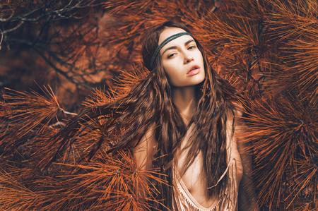 modelo desnuda: Outdoor fashion photo of beautiful lady hippie in a fir forest Foto de archivo