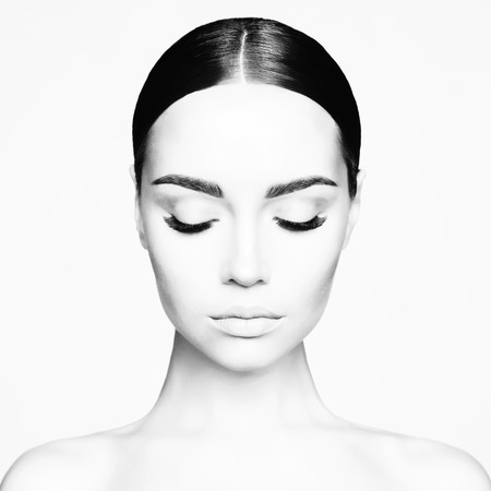 Black and white studio portrait of beautiful young woman. Beauty and care. Extension eyelashes. Spa salon