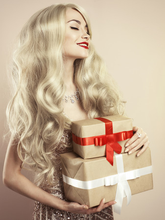 blonde woman: Fashion studio photo of luxury blonde with Christmas gift. Merry Christmas. Happy New Year