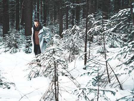 romantic sexy: Outdoor portrait of handsome man in coat and scurf. Casual winter fashion Stock Photo