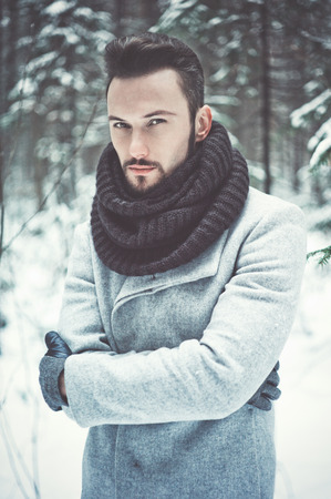 pretty model: Outdoor portrait of handsome man in coat and scurf. Casual winter fashion Stock Photo