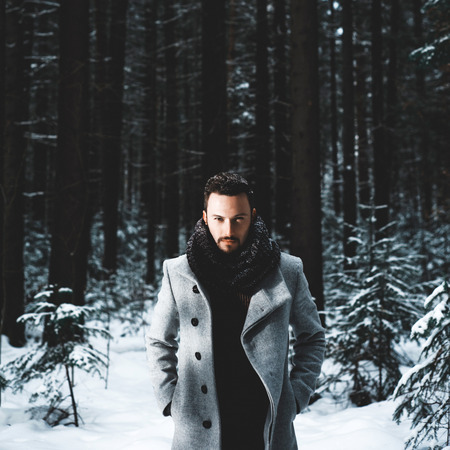 winter fashion: Outdoor portrait of handsome man in coat and scurf. Casual winter fashion Stock Photo