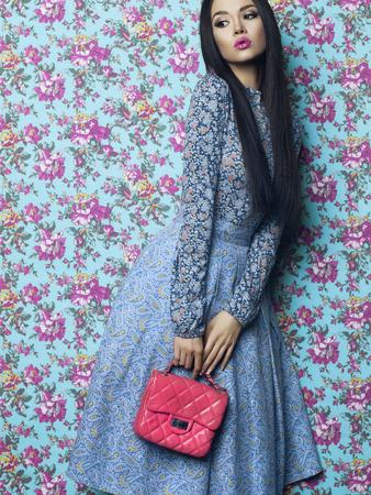 fashion art: Fashion art photo of beautiful elegant lady on floral background. Spring-Summer Stock Photo