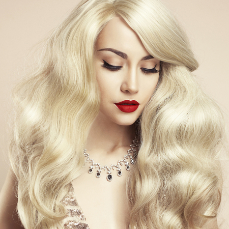 sexy party girl: Fashion studio photo of beautiful blonde with magnificent hair. Perfect makeup
