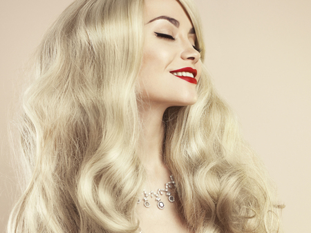red hair woman: Fashion studio photo of beautiful blonde with magnificent hair. Perfect makeup