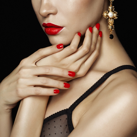 lip: Fashion studio photo of beautiful lady with red lips and nails