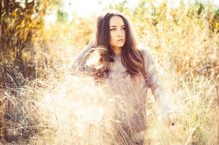 see through: Outdoor fashion photo of young beautiful lady in autumn landscape
