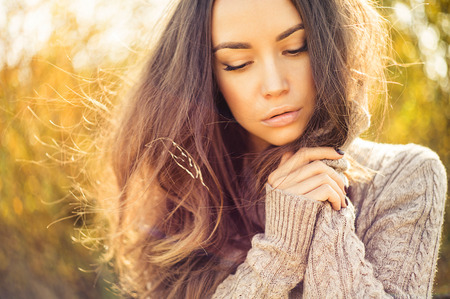 Outdoor fashion photo of young beautiful lady in autumn landscape