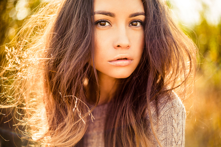 freedom: Outdoor atmospheric fashion photo of young beautiful lady. Brown hair and eyes. Warm autumn. Warm spring