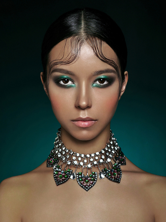 Fashion studio portrait of beautiful asian woman with diamond necklace. Fashion and Beauty. Perfect makeup 版權商用圖片 - 84011485