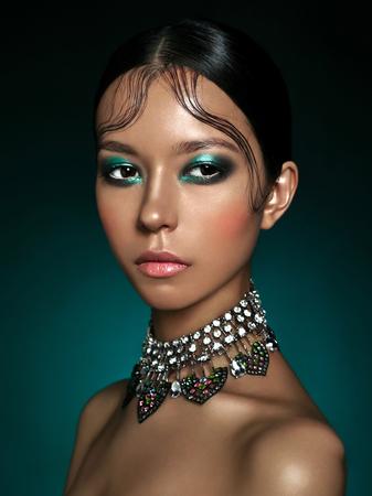 Fashion studio portrait of beautiful asian woman with diamond necklace. Fashion and Beauty. Perfect makeup