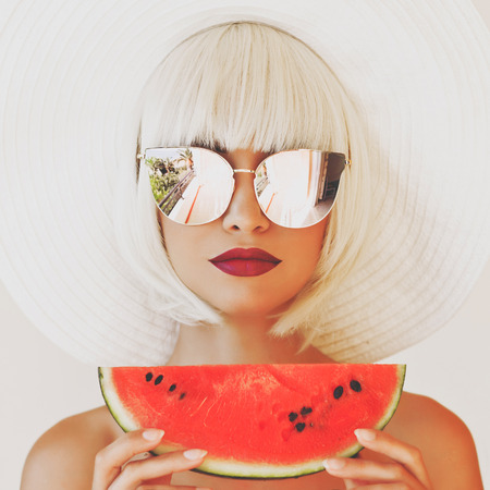 Outdoor fashion photo of young beautiful lady in hat and sunglasses with watermelon. Summer Beach travel. Summer vibes Stok Fotoğraf - 84013887
