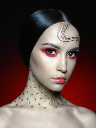 Fashion studio portrait of beautiful woman with bright red makeup. Fashion and Beauty. Perfect makeup Imagens