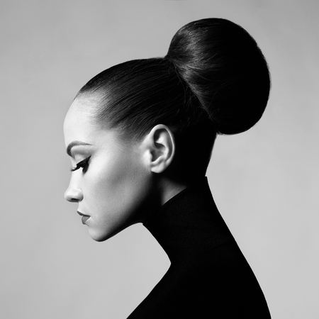 Black and white fashion art studio portrait of beautiful elegant woman in black turtleneck.  Hair is collected in high beam.  Elegant ballet style Stock Photo