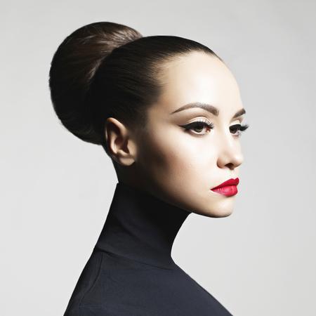 Fashion art studio portrait of beautiful elegant woman in black turtleneck.  Hair is collected in high beam.  Elegant ballet style Archivio Fotografico