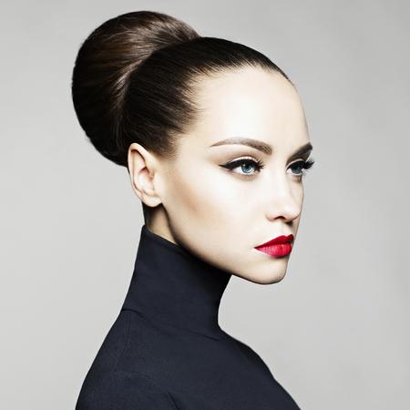 Fashion art studio portrait of beautiful elegant woman in black turtleneck.  Hair is collected in high beam.  Elegant ballet style Standard-Bild