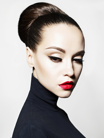 Fashion art studio portrait of beautiful elegant woman in black turtleneck.  Hair is collected in high beam.  Elegant ballet style Stock fotó