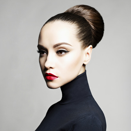 Fashion art studio portrait of beautiful elegant woman in black turtleneck.  Hair is collected in high beam.  Elegant ballet style Banque d'images