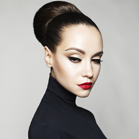Fashion art studio portrait of beautiful elegant woman in black turtleneck.  Hair is collected in high beam.  Elegant ballet style Stock Photo