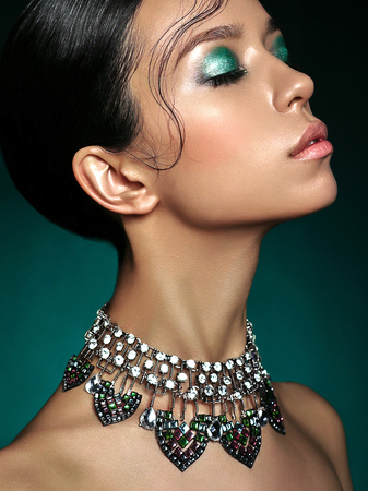 Fashion studio portrait of beautiful asian woman with diamond necklace. Fashion and Beauty. Perfect makeup