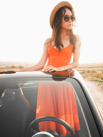 Outdoor lifestyle photo of beautiful happy woman in car cabriolet. Holiday and travel. Summer trip. Freedom, youth and carefree Stock Photo
