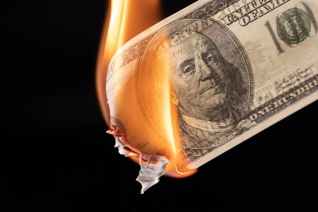 Dollar bill USA money burning in flames, economic crisis or inflation concept