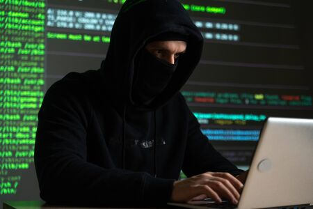 Hacker internet computer crime cyber attack network security programming code password protection Stockfoto