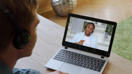 View over shoulder employer listen applicant at job interview online use cam.