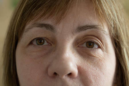 Close up of senior woman face and eye. Eyes of an elderly woman with wrinkles on the eyelids Stock Photo