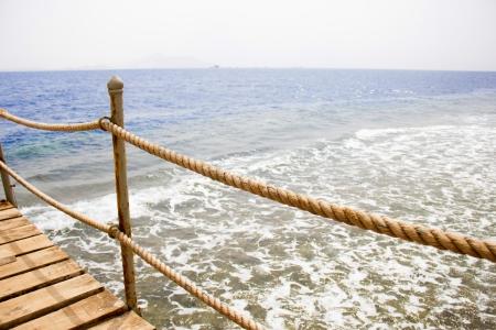 wooden dock: pier on the coast