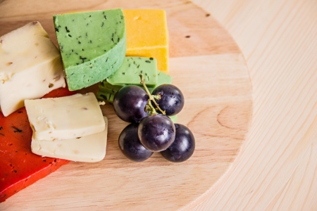 cheeses: cheeses on a cutting board