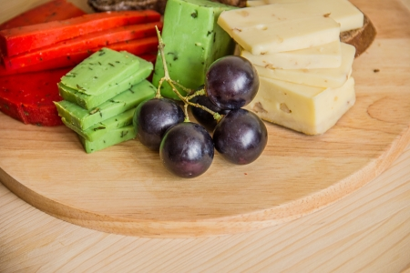 cheeses on a cutting board photo
