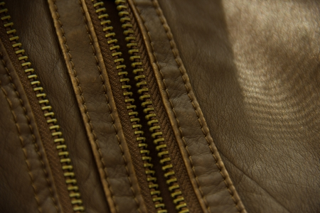 brown leather with metal zipper photo