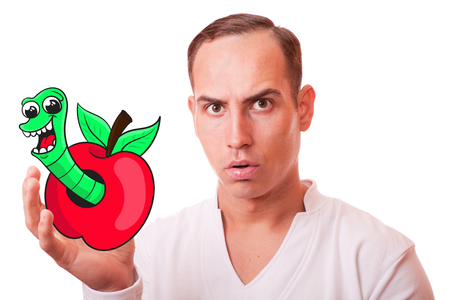 young man holding a wormy Apple