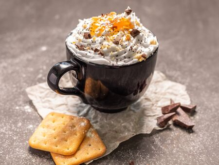 whipped cream dessert with apricot jam cookies and chocolate. 写真素材