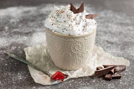 Milk cream mousse decorated with chocolate and Chia seeds.