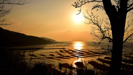 Okoshiki Coast is a beach selected as one of Japan's 100 best selections and Japan's 100 best sunsets.