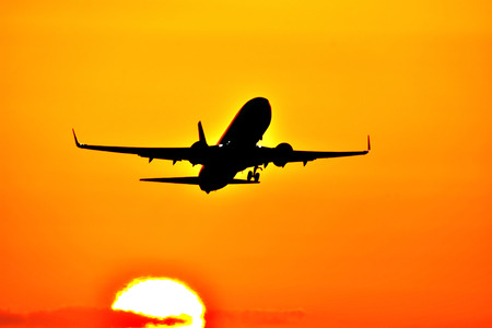Japanese aircraft landscape. Sunset and airplane. A scene where aircraft are intertwined in the most beautiful sunset