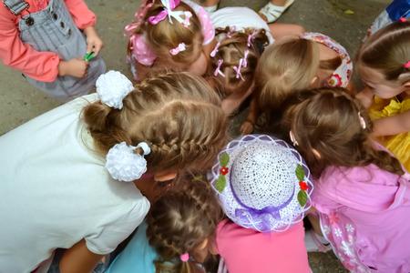 heads of young girls gathering around photo