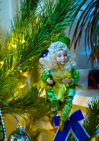 puppet toy is on the branch of Christmas tree photo
