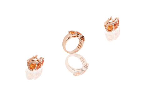 Yellow gold precious earrings ring with diamonds on white isolated background. Good material for design jewelery.