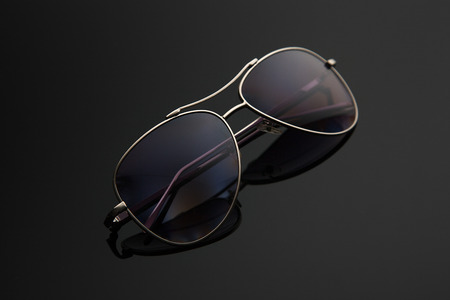 Sunglasses glasses form drop, metal frame for police, pilots, spies, stylish gradient background with polarizing filter. Stok Fotoğraf