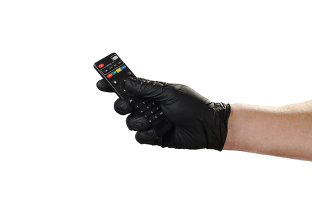 Hand shows gesture, good advertisement for security agency. Holds the remote from the TV.