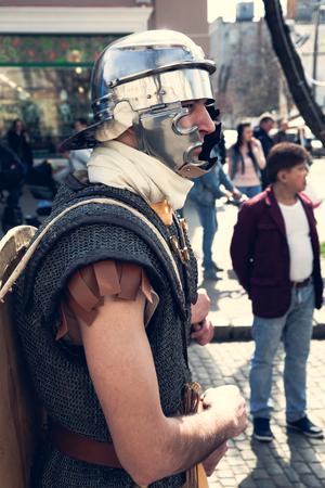 Odessa, Ukraine - March 2018 Roman legion empire soldiers old armor, swords, shields, banners Show. Editorial