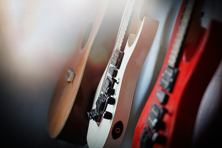 Close-up electric guitar sunbeams musical card. Musical string instrument, a good idea for music.