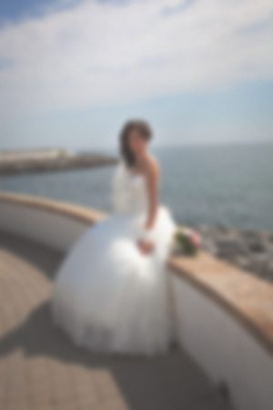 Blurred image of a wedding theme on the beach of the embankment of a young couple. European family is a good background for advertising.