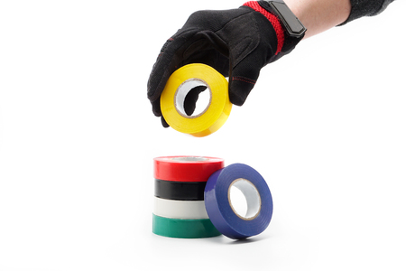 Colored adhesive tape, tape isolates, glues, accessory for home repair and at work building repair tool. Фото со стока